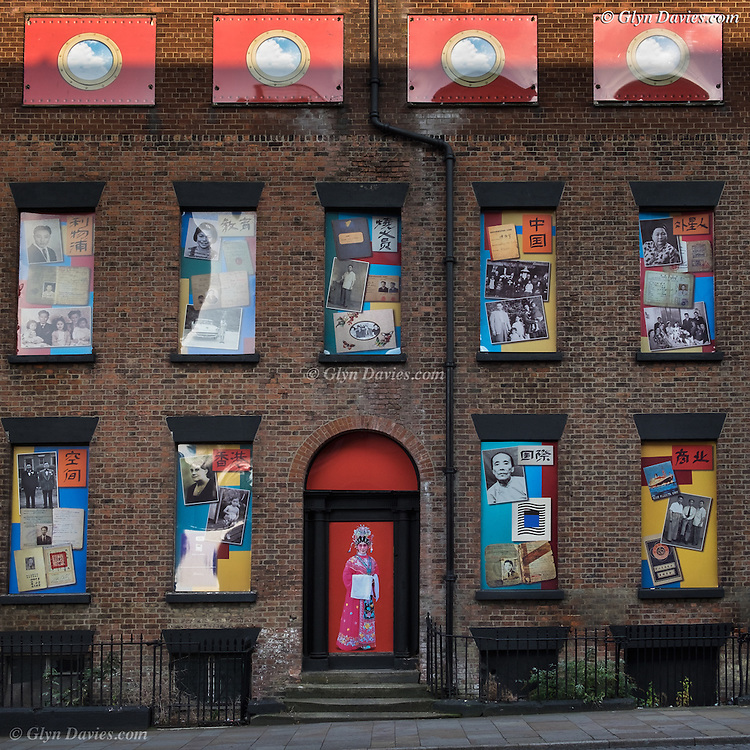 "A row of terraced houses in Duke Street has formed the backdrop to a unique piece of public art reflecting an important part of the city's history.<br /> Giant photographs which tell the story of Chinese sailors and their families have been installed on the houses which are next door to the Wah Sing Chinese School.<br /> The buildings, next to Iliad's development East Village at the top of Duke Street have been derelict for many years but the properties have now been given a new lease of life.<br /> The artwork "" Opera for Chinatown"" – has been created as part of a year-long project to create a digital archive of oral histories and family photographs of the Chinese community by artists and oral historians John Campbell and Moira Kenny also known as The Sound Agents."