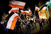 Frankfurt | 07 October 2016<br /> <br /> Am Freitag (07.10.2016) versammelten sich in Wetzlar etwa 80 Neonazis aus dem Umfeld der NPD, von neonazistischen Freien Kameradschaften, dem sog. Freien Netz Hessen und der Identit&auml;ren Bewegung zu einer Demonstration &quot;gegen &Uuml;berfremdung&quot;. Die geplante Demo-Route war von etwa 1600 Anti-Nazi-Aktivisten blockiert, daher wurde den Neonazis eine neue Demoroute durch Altstadt und Innenstadt von Wetzlar vorbei am Wetzlarer Dom zugewiesen. Auch hier stellten sich den Rechten immer wieder Aktivisten in den Weg.<br /> Hier: W&auml;hrend der Zwischenkundgebung der Neonazi-Demo schwenken Neonazis vor dem Dom von Wetzlar Fahnen in Schwarz-Weiss-Rot. <br /> <br /> photo &copy; peter-juelich.com<br /> <br /> FOTO HONORARPFLICHTIG, Sonderhonorar, bitte anfragen!