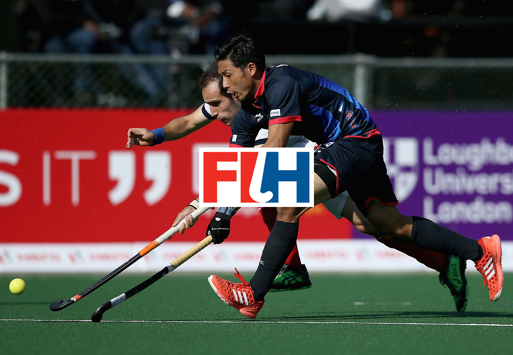 JOHANNESBURG, SOUTH AFRICA - JULY 13: Kenta Tanaka of Japan and Pieter van Straaten of France battle for possession during day 3 of the FIH Hockey World League Semi Finals Pool A match between Japan and France at Wits University on July 13, 2017 in Johannesburg, South Africa. (Photo by Jan Kruger/Getty Images for FIH)