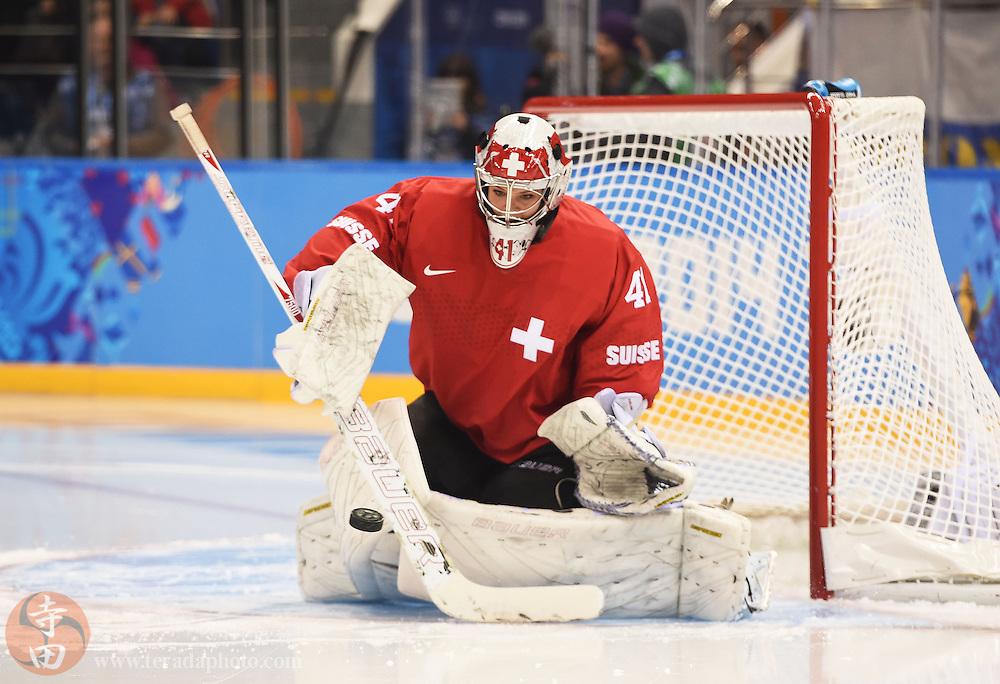 Feb 15, 2014; Sochi, RUSSIA; Switzerland goalkeeper Florence Schelling (41) makes a save in a women's quarterfinals ice hockey game during the Sochi 2014 Olympic Winter Games at Shayba Arena.