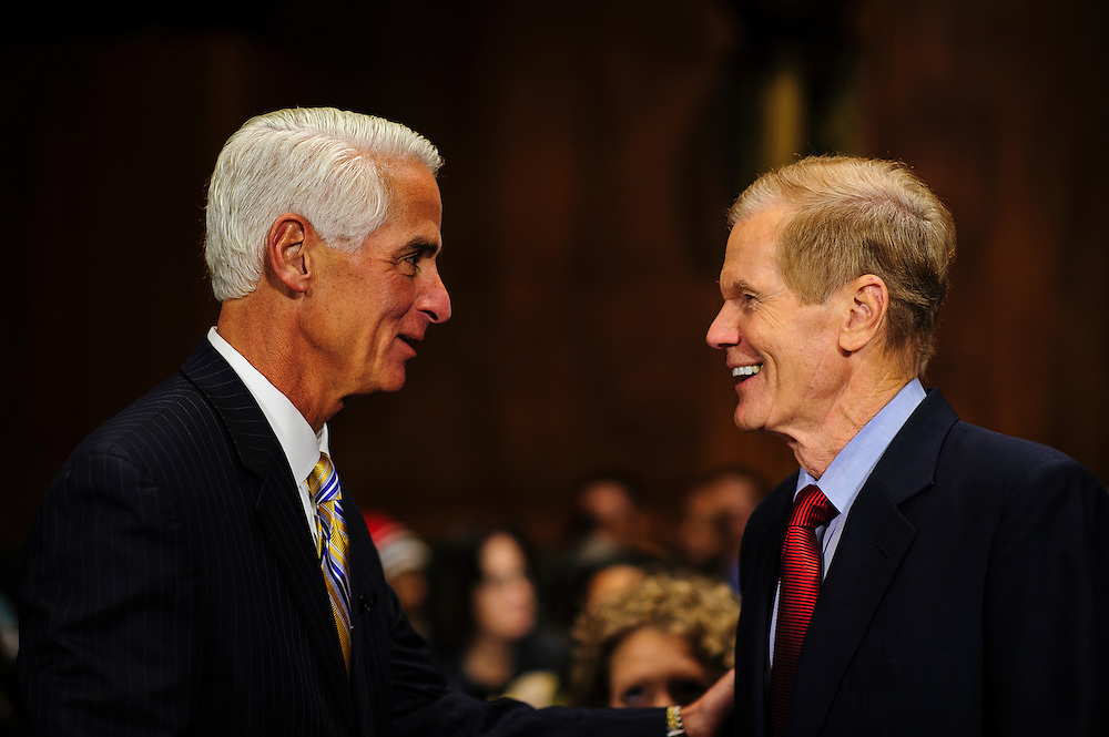 """Former Florida Governor CHARLIE CRIST meets with Senator BILL NELSON (D-FL) before testifying at a Senate Judiciary Committee hearing on Captiol Hill Wednesday about """"The State Of The Right To Vote After The 2012 Election."""" The hearing focused on American's access to the voting booth and the continuing need for protections against efforts to limit or suppress voting."""