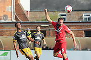 York City defender John McCoombe heads toward goal watched by Cambridge United defender Leon Legge  during the Sky Bet League 2 match between York City and Cambridge United at Bootham Crescent, York, England on 3 October 2015. Photo by Simon Davies.