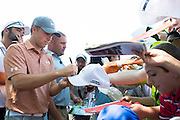 Jordan Spieth signs autographs after the final round of the AT&T Byron Nelson in Las Colinas, Texas on May 31, 2015. (Cooper Neill for The New York Times)