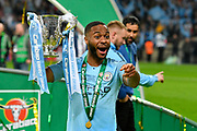 Raheem Sterling (7) of Manchester City celebrates with the Carabao Cup after City won the final on penalties during the Carabao Cup Final match between Chelsea and Manchester City at Wembley Stadium, London, England on 24 February 2019.