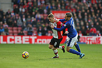 Football - 2017 / 2018 Premier League - Southampton vs. Everton<br /> <br /> Gylfi Sigurosson of Everton gets to grips with Southampton's Steven Davis at St Mary's Stadium Southampton<br /> <br /> COLORSPORT/SHAUN BOGGUST