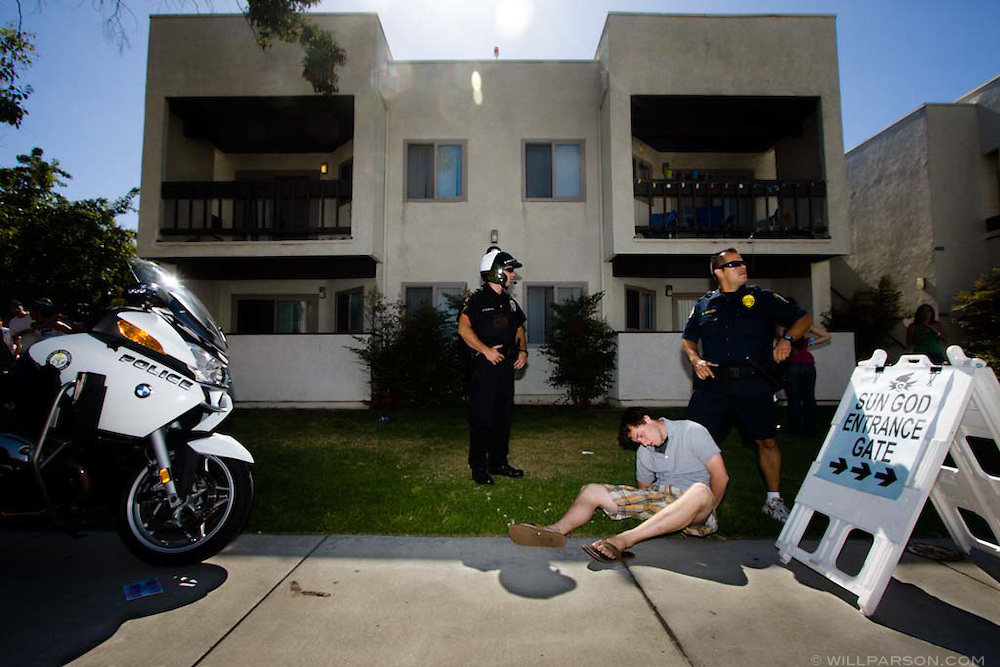 Police detain a student during the Sun God Festival on the UC San Diego campus on May 16, 2008 in San Diego, California.  Extra security measures during the day-long festival sought to keep the surge of inebriated students and visitors under control.