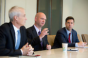 Dave Wilson (center), gives remarks during an interview at Nuveen Asset Management in downtown Chicago, Ill., on Wednesday, September 23, 2015.