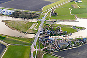 Nederland, Friesland, Gemeente Dongeradeel, 28-02-2016; Dokkumer Nieuwe Zijlen, buurtschap en sluiscomplex. Spui- en schutsluizen tussen Dokkumerdiep en voormalige Lauwerszee.<br /> <br /> luchtfoto (toeslag op standard tarieven);<br /> aerial photo (additional fee required);<br /> copyright foto/photo Siebe Swart