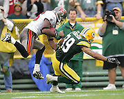 GREEN BAY, WI - SEPTEMBER 25:  Wide receiver Robert Ferguson #89 of the Green Bay Packers falls to the ground during an interception by safety Will Allen #26 of the Tampa Bay Buccaneers late in the game at Lambeau Field on September 25, 2005 in Green Bay, Wisconsin. The Buccaneers defeated the Packers 17-16. ©Paul Anthony Spinelli *** Local Caption *** Robert Ferguson;Will Allen