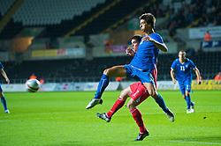 SWANSEA, ENGLAND - Friday, September 4, 2009: Wales' Mark Bradley and Italy's Lorenzo Ariaudo during the UEFA Under 21 Championship Qualifying Group 3 match at the Liberty Stadium. (Photo by David Rawcliffe/Propaganda)