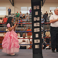 Shania Saeli, 7, sings the national anthem as boxing referee Bill Stankowski places his hand over his heart at the North Carolina Azalea Festival Boxing Tournament at Williston Middle School.Saturday, April 13, 2013. Photo by Mike Spencer