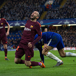 Aleix Vidal of Barcelona reacts to a tackle from Marcos Alonso of Chelsea during the Champions League match between Chelsea and Brcelona at Stamford Bridge, London on Tuesday 20th February 2018.  (C) Steven Morris | SportPix.org.uk
