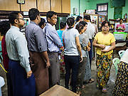 08 NOVEMBER 2015 - YANGON, MYANMAR: People line up in their polling station in central Yangon. The citizens of Myanmar went to the polls Sunday to vote in the most democratic elections since 1990. The National League for Democracy, (NLD) the party of Aung San Suu Kyi is widely expected to get the most votes in the election, but it is not certain if they will get enough votes to secure an outright victory. The polls opened at 6AM. In Yangon, some voters started lining up at 4AM and lines were reported to long in many polling stations in Myanmar's largest city.      PHOTO BY JACK KURTZ