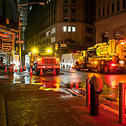 November 2, 2012 - New York, NY : Trucks continued to pump water from flooded sections of lower Manhattan on Thursday night/Friday morning. Here, the scene on Broad Street near Stone Street in lower Manhattan early on Friday morning. CREDIT: Karsten Moran