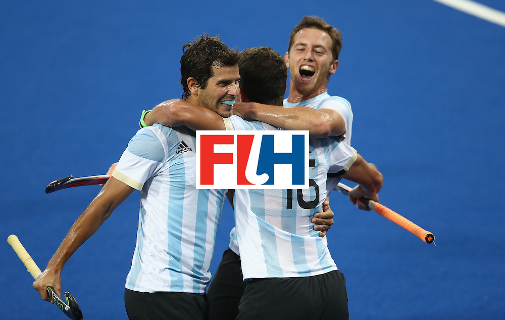 RIO DE JANEIRO, BRAZIL - AUGUST 18:  Ignacio Ortiz of Argentina celebrates with team mates after scoring their secod goal during the Men's Gold Medal match between Argentina and Belgium on Day 13 of the Rio 2016 Olympic Games held at the Olympic Hockey Centre on August 18, 2016 in Rio de Janeiro, Brazil.  (Photo by David Rogers/Getty Images)