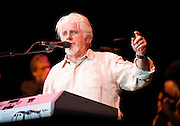 Michael McDonald<br /> playing live at the O2 Arena, London, Great Britain <br /> 27th June 2010 <br /> <br /> <br /> <br /> <br /> Michael McDonald (born February 12, 1952) is a five-time Grammy Award winning American singer and songwriter. Sometimes described as a &quot;blue-eyed soul&quot; singer, McDonald has a distinctive &quot;husky, soulful&quot; baritone voice.[1] He is known as a member of the Doobie Brothers and backing vocal-work with Steely Dan. In addition, he has had a productive solo career with several hit songs to his credit.