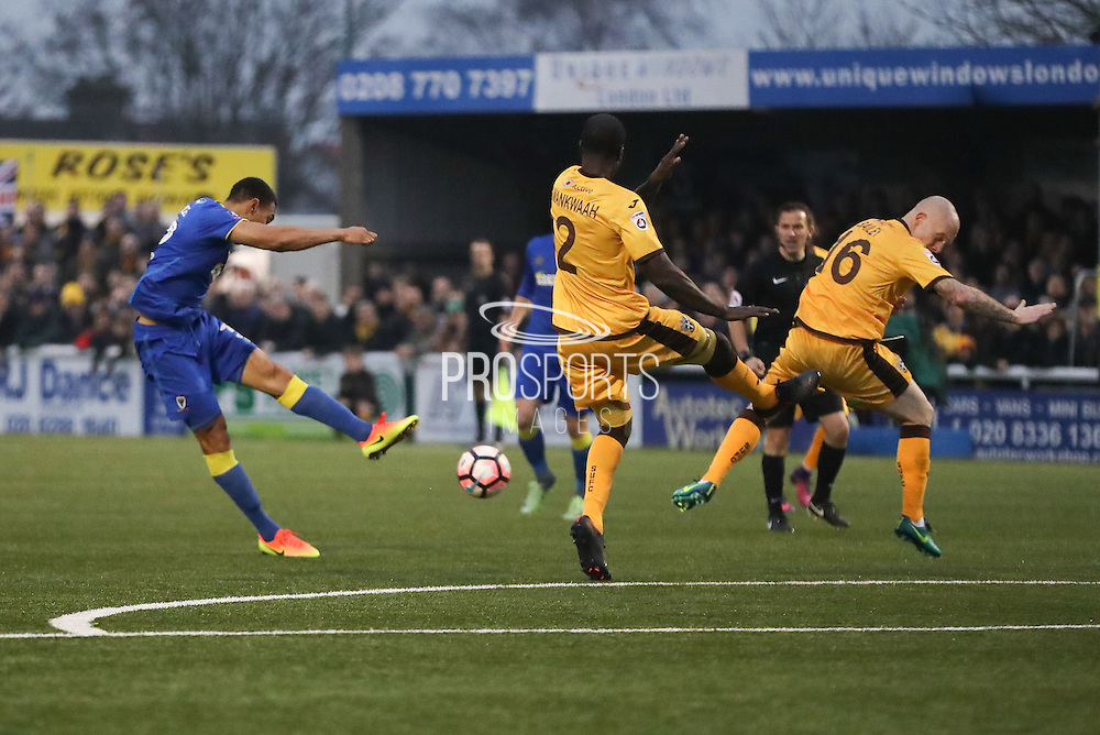 AFC Wimbledon defender Darius Charles (32) shoots at goal during The FA Cup match between Sutton United and AFC Wimbledon at Gander Green Lane, Sutton, United Kingdom on 7 January 2017. Photo by Stuart Butcher.