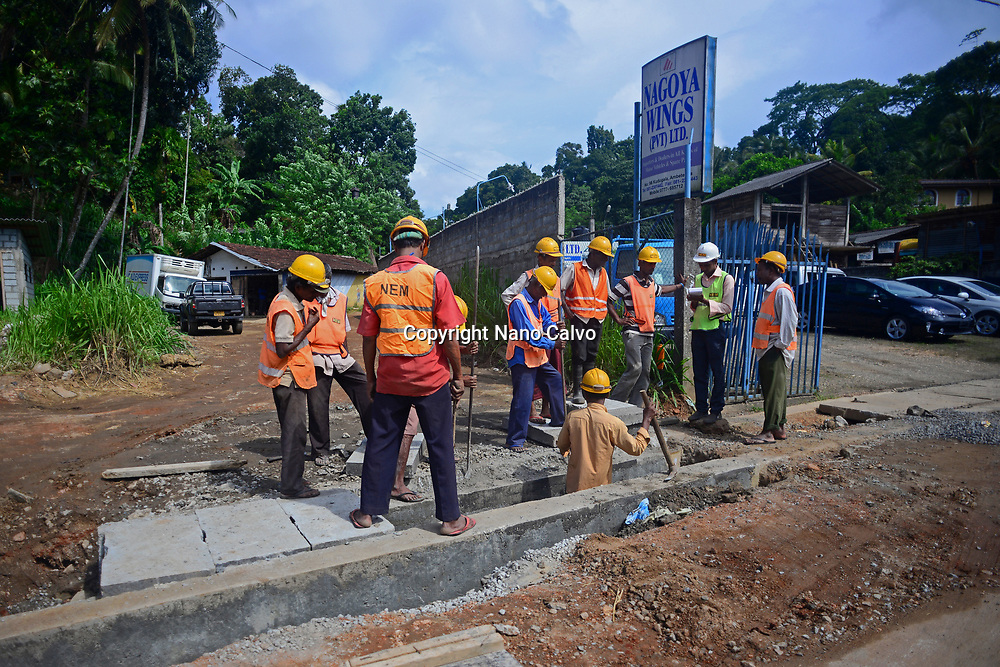 Group of construction men working in the street, Matale, Sri Lanka