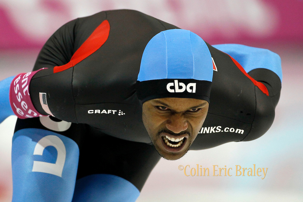 Shani Davis of the USA, competes in the men's 1500- meter World Cup speedskating competition at the Utah Olympic Oval in Kearns, Utah, Friday, Feb. 18, 2011. (AP Photo/Colin E Braley)