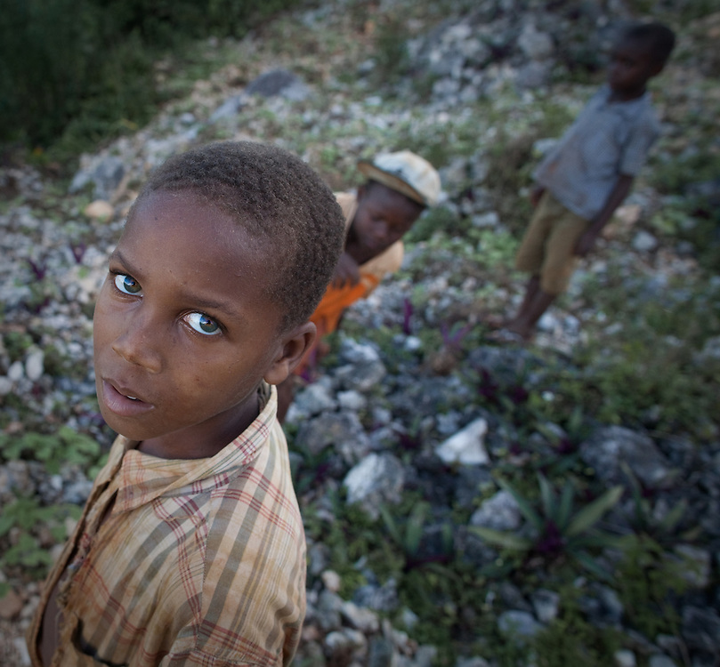 Boys play around a fort on the slopes of the Massif de la Hotte, Haiti