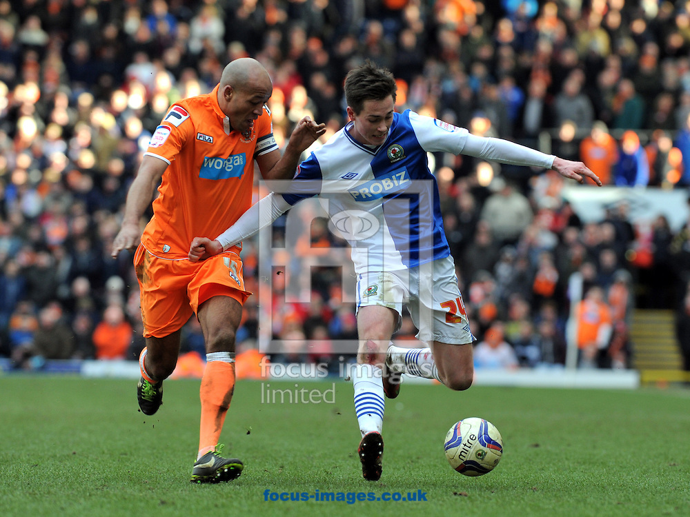 Picture by Alan Wright/Focus Images Ltd 07733 196489.29/03/2013.Josh Morrisof Blackburn Rovers and Ludovic Sylvestre  of Blackpool during the npower Championship match at Ewood Park, Blackburn.