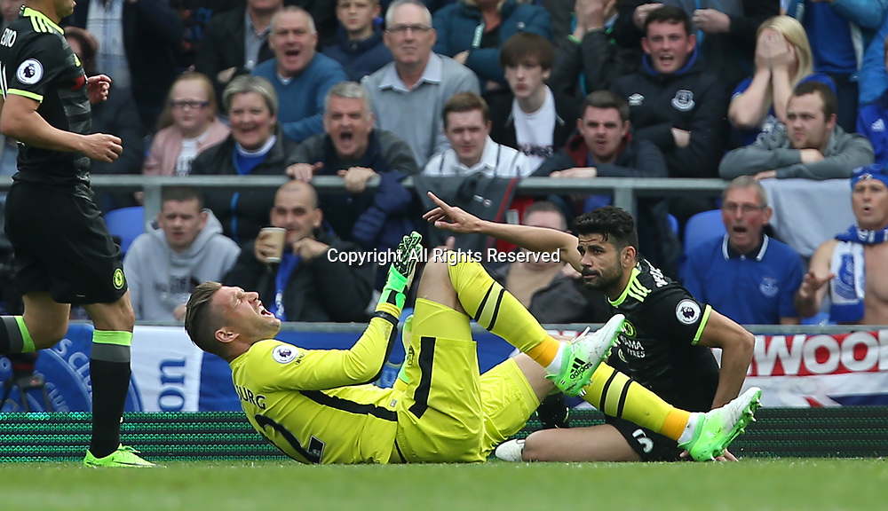 April 30th 2017, Goodison Park, Liverpool, England; EPL Premier league football, Everton versus Chelsea; Diego Costa of Chelsea follows through on a loose ball and fouls Maarten Stekelenburg,Everton goalkeeper and is awarded a yellow card