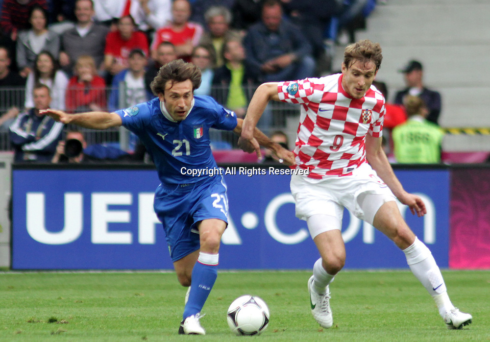 14.06.2012. Poznan, Poland.  EURO 2012, FOOTBALL EUROPEAN CHAMPIONSHIP, Italy versus Croatia.  ANDREA PIRLO (ITA)  , NIKICA JELAVIC (CRO) The game ended in a 1-1- draw.