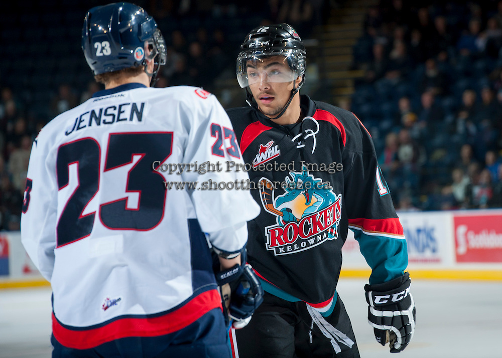 KELOWNA, CANADA, OCTOBER 16 - Tyrell Goulbourne #12 of the Kelowna Rockets gets ready to drop the gloves with Kade Jesen #23 of the Lethbridge Hurricanes on Wednesday, October 16, 2013 at Prospera Place in Kelowna, British Columbia (photo by Marissa Baecker/Getty Images)***Local Caption***