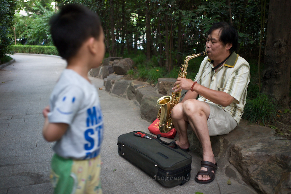 Street musician, Fuxing Park, Shanghai, China.