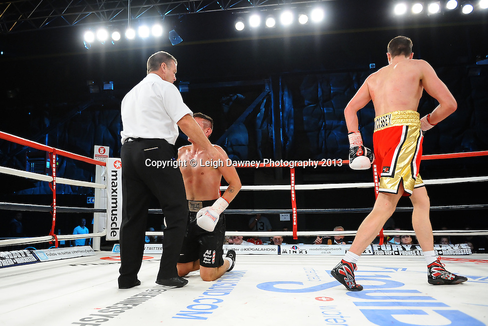 Tom McAssey knocks down Liam Griffiths on Saturday 14th September 2013 at the Magna Centre, Rotherham. Hennessy Sports. Self billing applies. © Credit: Leigh Dawney Photography.