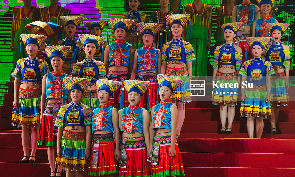 Zhuang people in traditional clothing on the stage at March 3 Song Festival, Wuming, Guangxi Province, China