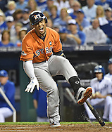 Houston Astros center fielder Carlos Gomez (30) reacts after fouling a ball off his foot against the Kansas City Royals in game five of the ALDS at Kauffman Stadium.