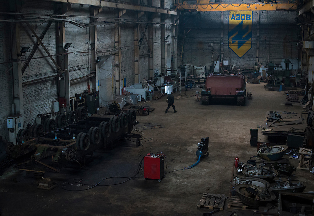 An overview of Azov Engineering Group's building is seen on September 9, 2015 in Kyiv, Ukraine. At left is an inverted tank chassis in the process of being stripped down before being rebuilt as a new vehicle like the one at top left, which went through a similar process.