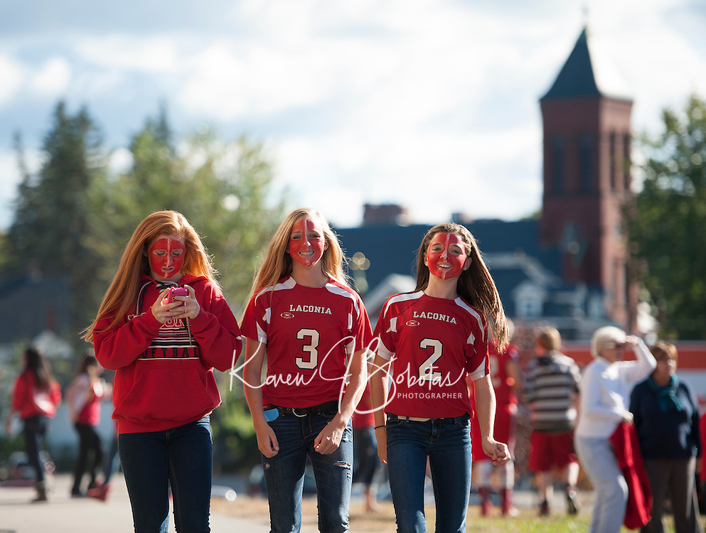 """Laconia """"Pride"""" on the faces of LHS students marching in the Homecoming parade Friday afternoon.  (Karen Bobotas/for the Laconia Daily Sun)"""