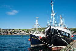 View of harbour with fishing trawlers at Campbeltown on Kintyre Peninsula in Argyll and Bute in Scotland United Kingdom