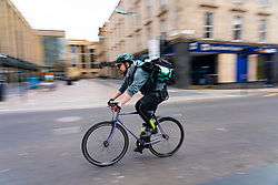 Glasgow, Scotland, UK. 1 April, 2020. Effects of Coronavirus lockdown on Glasgow life, Scotland. Deliver delivery man on bike rides past Sauchiehall Street.