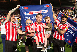 left to right Harry Anderson of Lincoln City Harry Toffolo of Lincoln City and Bruno Andrade of Lincoln City celebrate promotion.  - Mandatory by-line: Alex James/JMP - 22/04/2019 - FOOTBALL - Sincil Bank Stadium - Lincoln, England - Lincoln City v Tranmere Rovers - Sky Bet League Two