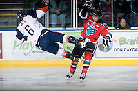 KELOWNA, CANADA - NOVEMBER 1:  Tyrell Goulbourne #12 of the Kelowna Rockets checks Tyler Bell #6 of the Kamloops Blazers at the Kelowna Rockets on November 1, 2012 at Prospera Place in Kelowna, British Columbia, Canada (Photo by Marissa Baecker/Shoot the Breeze) *** Local Caption ***