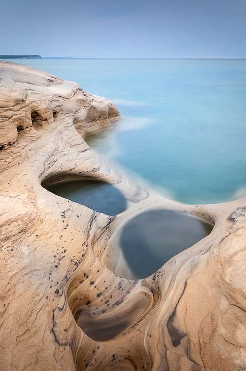 Interesting holes and patterns in the sandstone along the Lake Superior shore.  <br />