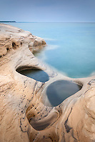 Interesting holes and patterns in the sandstone along the Lake Superior shore.  <br /> Pictured Rocks National Lakeshore<br /> Michigan's Upper Peninsula