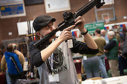 Christian DuBrul checks a gun at the Central Vermont Gun Show in Barre, Vermont.