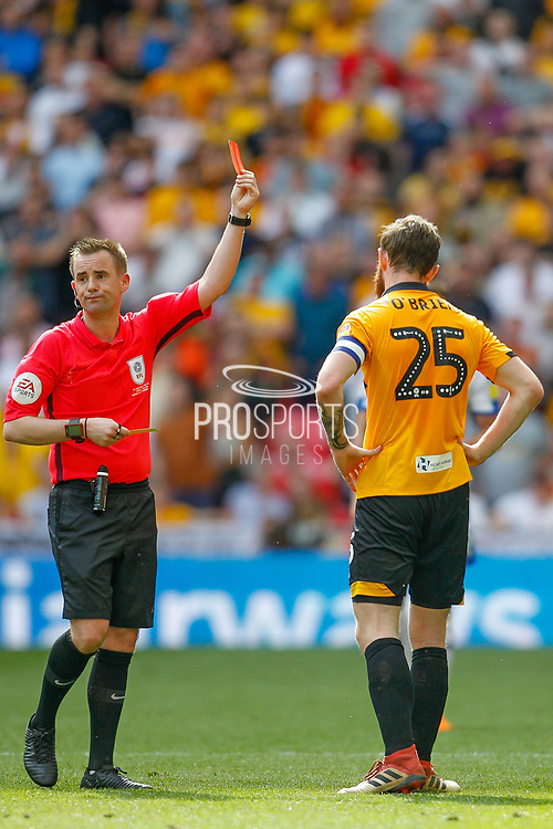 Referee Ross Joyce gives Newport County defender Mark O'Brien (25) a red card after his second yellow, during the EFL Sky Bet League 2 Play Off Final match between Newport County and Tranmere Rovers at Wembley Stadium, London, England on 25 May 2019.