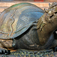 Bronze Turtle at Forbidden City in Beijing, China<br /> You will notice several bronze turtles during your tour of Forbidden City. Some people believe Chinese script was derived from the markings on the back of a tortoise. They symbolize longevity, power and the universe. As one of China&rsquo;s four great mythological animals, the Black Tortoise or Warrior (Xu&aacute;nwǔ) rules the North in the Chinese constellation. Turtles were also often used to support the memorial tablets of emperors.