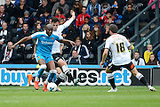 Derby County midfielder George Thorne holds up Wolverhampton Wanderers striker Benik Afobe during the Sky Bet Championship match between Derby County and Wolverhampton Wanderers at the iPro Stadium, Derby, England on 18 October 2015. Photo by Alan Franklin.