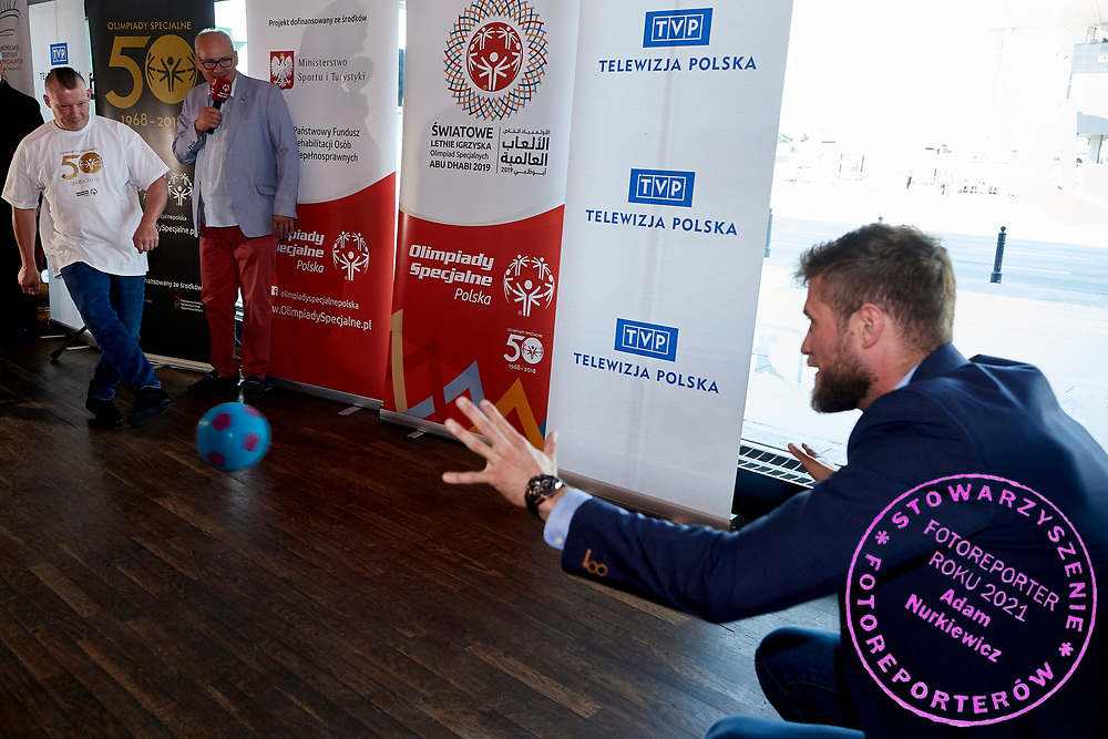 Warsaw, Poland - 2018 May 10: (L) Special Olympics Athete Robert Sosnowski shoots on goal and (R) Andrzej Wrona saves Special Olympics Press Conference at Marriott Champions Sport Bar on May 10, 2018 in Warsaw, Poland.<br /> <br /> Adam Nurkiewicz declares that he has no rights to the image of people at the photographs of his authorship.<br /> <br /> Picture also available in RAW (NEF) or TIFF format on special request.<br /> <br /> Any editorial, commercial or promotional use requires written permission from the author of image.<br /> <br /> Image can be used in the press when the method of use and the signature does not hurt people on the picture.<br /> <br /> Mandatory credit:<br /> Photo by &copy; Adam Nurkiewicz / Mediasport