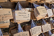 Wooden prayer placards left by visitors to the Meiji Shrine, Tokyo.