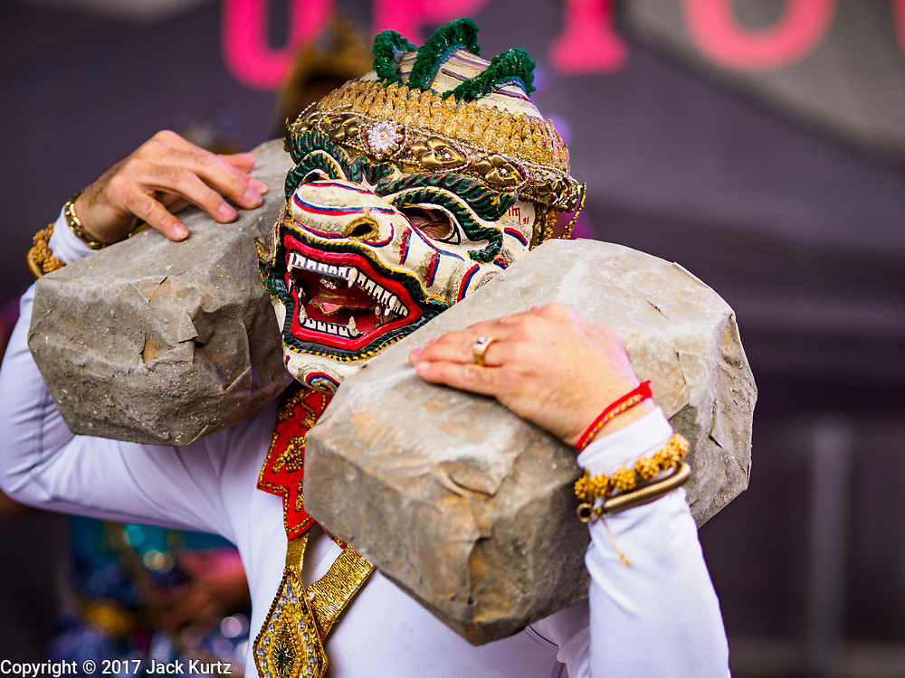 """29 APRIL 2017 - MINNEAPOLIS, MINNESOTA: Men wear Khon masks perform a dance from the Ramakien (Thai version of the Indian epic, the Ramayana) during Songkran Uptown. Several thousand people attended Songkran Uptown on Hennepin Ave in Minneapolis for the city's first celebration of Songkran, the traditional Thai New Year. Events included a Thai parade, a performance of the Ramakien (the Thai version of the Indian Ramayana), a """"Ladyboy"""" (drag queen) show, and Thai street food.     PHOTO BY JACK KURTZ"""