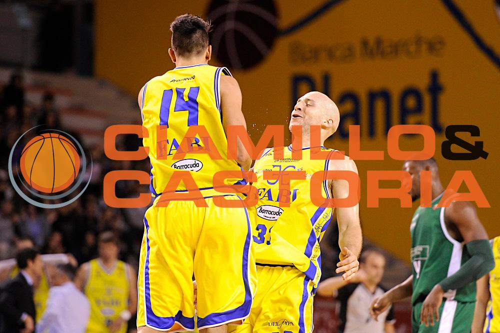 DESCRIZIONE : Ancona Lega A 2011-12 Fabi Shoes Montegranaro Benetton Treviso<br /> GIOCATORE : Greg Brunner Valerio Mazzola<br /> CATEGORIA : esultanza<br /> SQUADRA : Fabi Shoes Montegranaro<br /> EVENTO : Campionato Lega A 2011-2012<br /> GARA : Fabi Shoes Montegranaro Benetton Treviso<br /> DATA : 03/12/2011<br /> SPORT : Pallacanestro<br /> AUTORE : Agenzia Ciamillo-Castoria/C.De Massis<br /> Galleria : Lega Basket A 2011-2012<br /> Fotonotizia : Ancona Lega A 2011-12 Fabi Shoes Montegranaro Benetton Treviso<br /> Predefinita :
