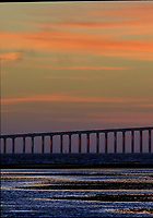 Sunshine Skyway Bridge at Dawn from Fort De Soto Park. Split print 1 of 6 images taken with a Fuji X-H1 camera and 200 mm f/2 OIS lens (ISO 400, 200 mm, f/11, 1/20 sec). Raw images processed with Capture One Pro and AutoPano Giga Pro.