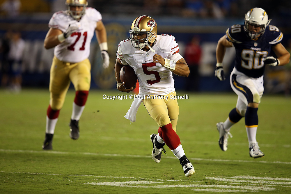 San Francisco 49ers quarterback B.J. Daniels (5) runs for a gain of 36 yards and a fourth quarter first down during the NFL week 4 preseason football game against the San Diego Chargers on Thursday, Aug. 29, 2013 in San Diego. The 49ers won the game 41-6. ©Paul Anthony Spinelli